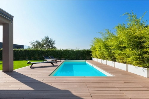 swimming pool surrounded with wooden deck